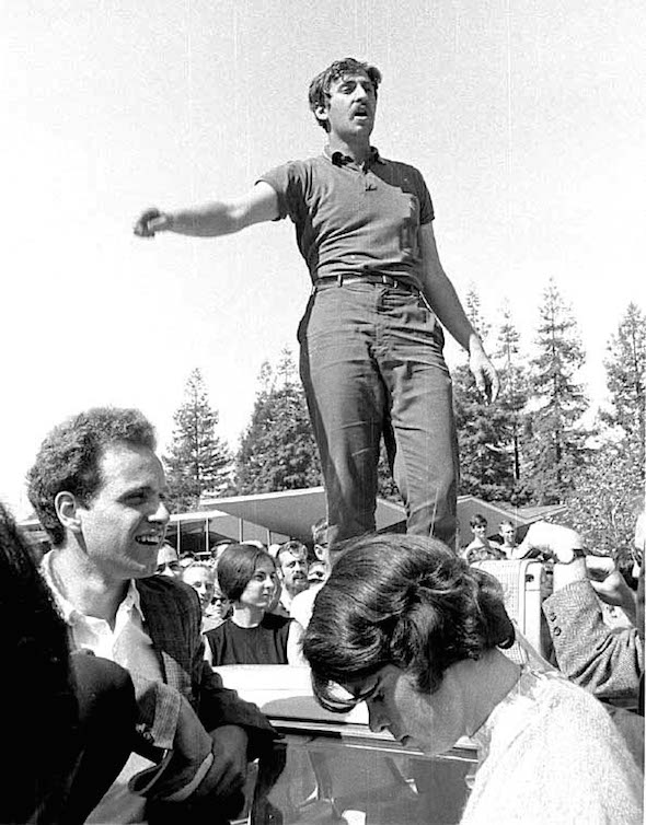 Jack Weinberg atop car by Steven Marcus